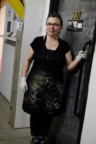 Photo of Donna standing at her studio door